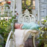 Newborn photography of sweet baby wrapped and in a chair milford michigan photography