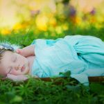 Newborn photography of sweet baby wrapped and in the grass milford michigan photography