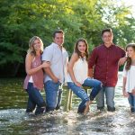 Lifestyle photography with family in a stream or river milford michigan photography