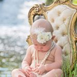 Child photography of sweet girl wrapped in pearls milford michigan photography